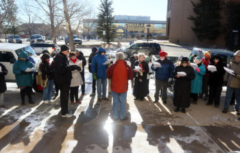 Highlands United Presbyterian Church Pastor Rodger McDaniel speaks with people during a Juntos prayer vigil in front of the United States Immigration and Customs Enforcement office on Monday, Jan. 15, 2018, in Cheyenne. Around 50 people attended the vigil to show their opposition to an ICE detention center proposed for Evanston. Blaine McCartney/Wyoming Tribune Eagle