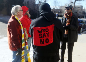 Juntos Chairman Antonio Serrano visits with Highlands United Presbyterian Pastor Rodger McDaniel, Jason Bloomberg and Mohamed Salih, from left, during a Juntos prayer vigil in front of the United States Immigration and Customs Enforcement office on Monday, Jan. 15, 2018, in Cheyenne. Around 50 people attended the vigil to show their opposition to an ICE detention center proposed for Evanston. Blaine McCartney/Wyoming Tribune Eagle